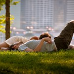 in-love-couple-sitting-on-grass-relaxing-city-park-wide-hd-wallpaper